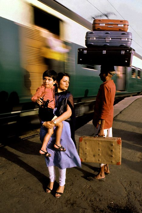This is a good photojournalism example because the train is moving fast while the family is moving still.