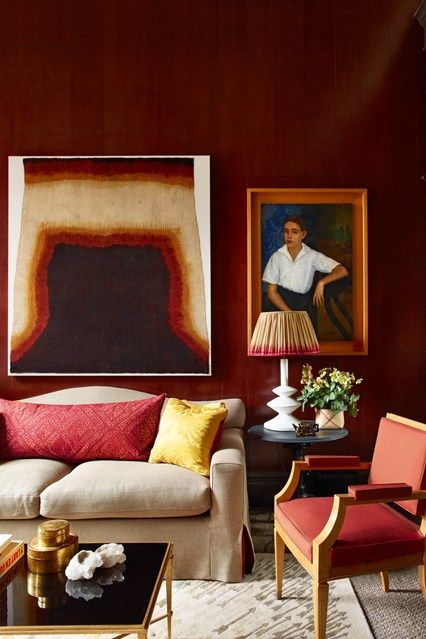 In the study of Douglas Mackie's Marylebone flat, there is plenty of inspiration for a living room. Oxblood red walls provide a dramatic backdrop for a portrait by Spanish-Cuban artist José Segura Ezquerro and a lampshade made from an antique sari.  (houseandgarden.co.uk)