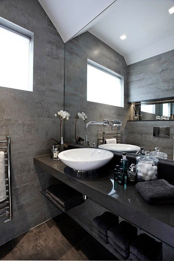 glamorous black stone (marble?)vanity shelf with white countertop basin - The Gatekeepers Cottage by Boscolo Ltd - does anyone know where I can buy a similar stone vanity shelf in the UK? Also suggestions on what the walls tiles may be please?
