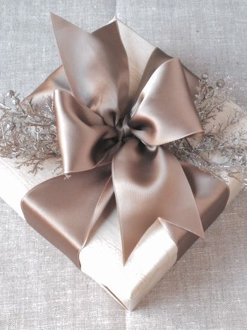 Learn to tie the perfect Tiffany's gift bow.