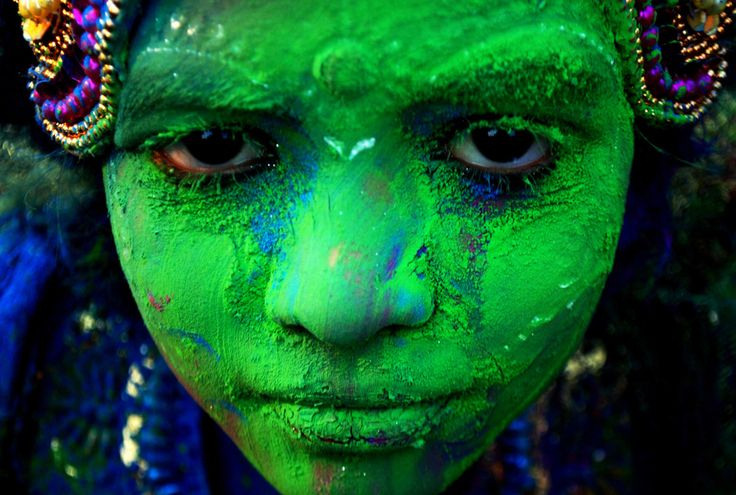March 16, 2014 | An Indian child adorned with colored powder poses for a photograph while taking part in celebrations for the spring festival Holi in Bhubaneswar. Holi, the popular Hindu spring festival of colors is observed in India at the end of the winter season on the last full moon of the lunar month | Asit Kumar / AFP / Getty Images | #photojournalism