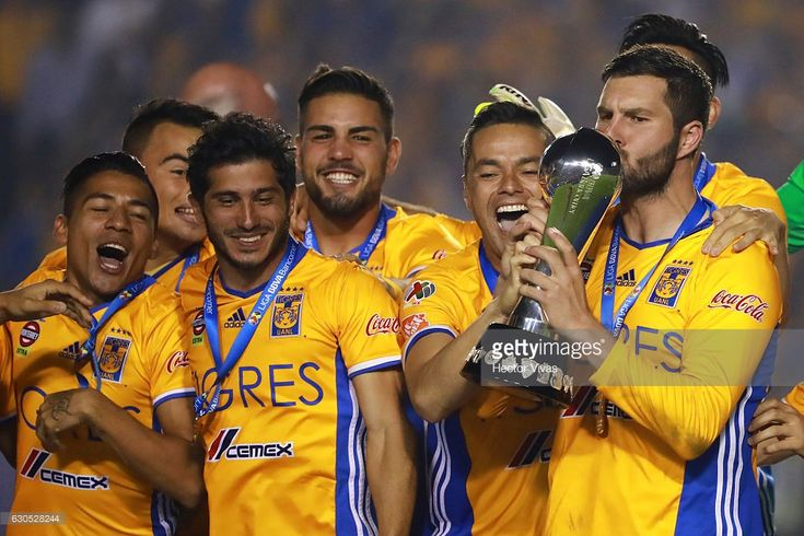 Andre Pierre Gignac of Tigres kisses the champion trophy after the Final second leg match between Tigres UANL and America as part of the Torneo Apertura 2016 Liga MX at Universitario Stadium on December 25, 2016 in Monterrey, Mexico.