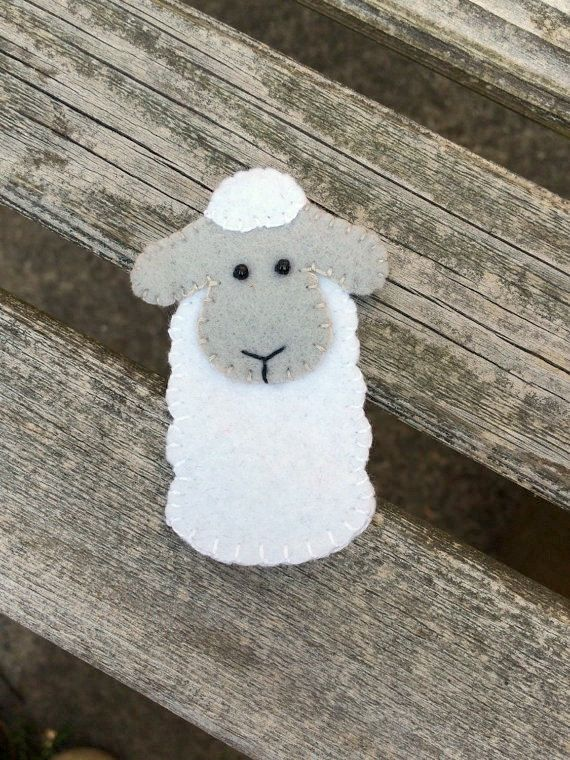 Little white sheep finger puppet for all your barnyard adventures. 2 wide from ear to ear and 2.75 tall Hand sewn from original design with