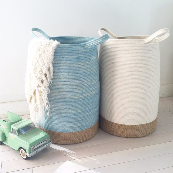 This is a hand made 14X20 basket with unbleached 100% natural cotton cord rope, and 100% natural jute rope at the bottom. it is soft and flexible to touch, yet sturdy, stands upright on its own, and will hold its shape. Use this multifunctional basket to store toys, books, blankets, clothes, kindling, or use it as a large laundry basket. it is light weight, and its 10 long handles make it easy to transport. use for all your storage needs, or as a decorative accent piece. 14wide at the…