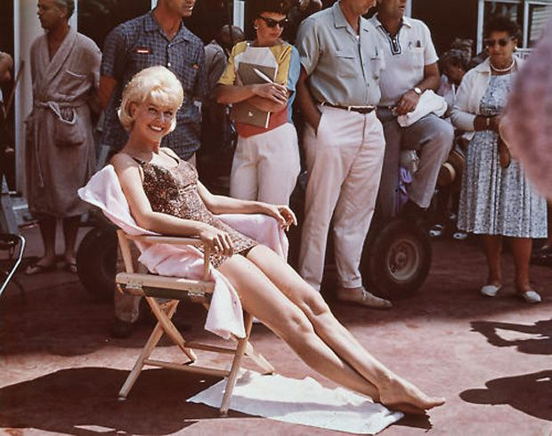 "Doris Day getting some sun on the set of ""That Touch of Mink."""