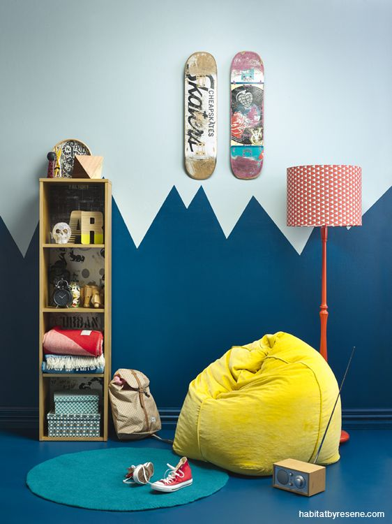Shades of blue for teenage boy's bedroom. Resene Prussian Blue is used on the bottom, with Resene Eskimo on top.