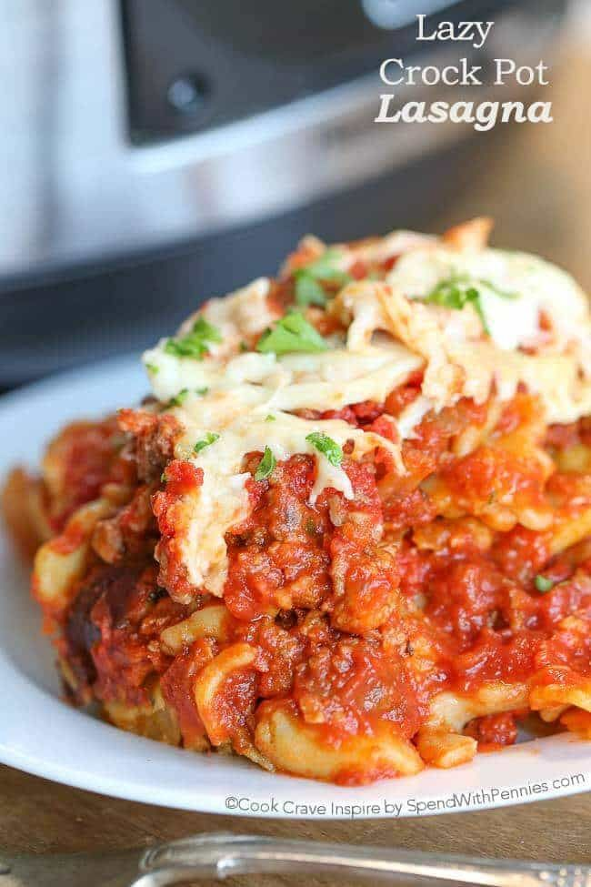 Lazy Crock Pot Lasagna is fast and easy to make! A delicious meat sauce is layered with cheese & spinach filled ravioli and mozzarella cheese.