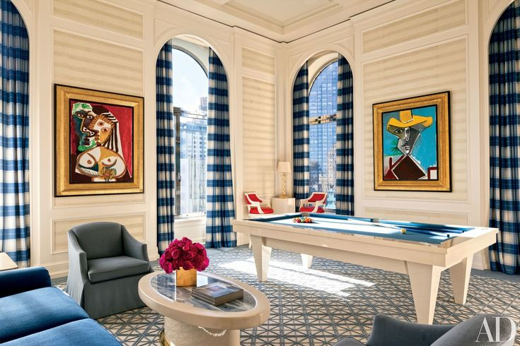 In this Manhattan duplex decorated by Roger Thomas, the game room is anchored by a Blatt Billiards table and features two Picasso paintings.