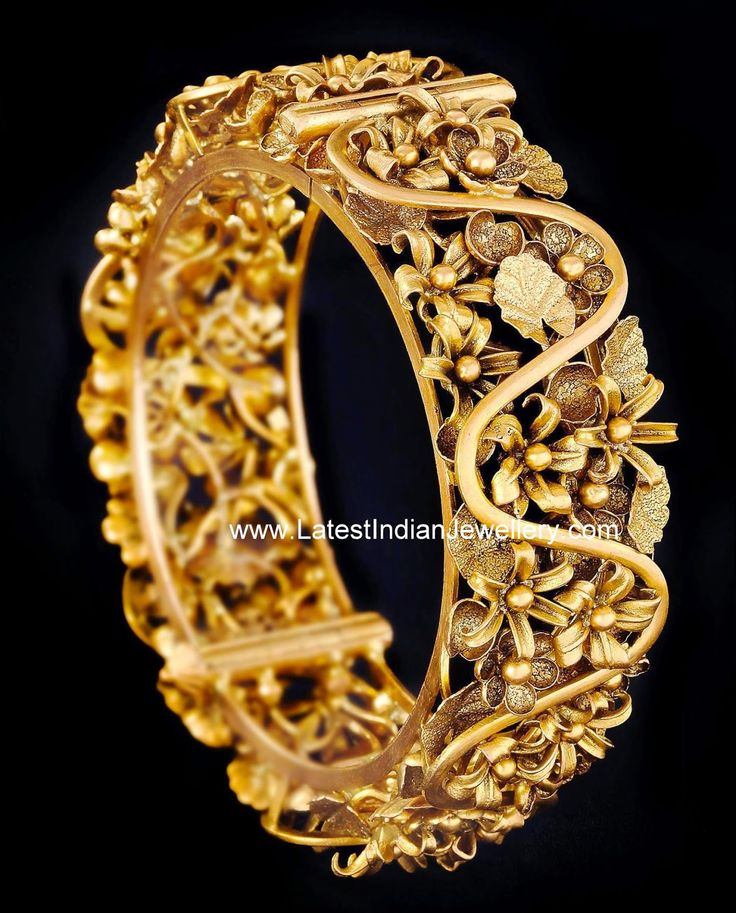 floral design broad gold bangle