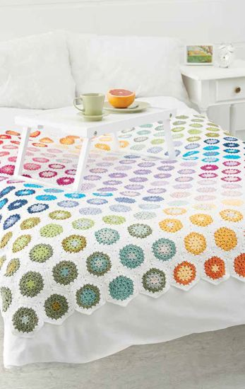 A cool spin on granny squares--pinwheeling hexagons! The color placement, based on the color wheel, is what makes this crocheted blanket so eye-catching.