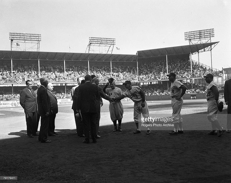 Brooklyn Dodgers captain Pee Wee Reese shakes hands with President Dwight Eisenhower before the first game of the 1956 World Series at Ebbets Field in Brooklyn, New York. Also pictured are baseball executives Ford Frick and Warren Giles, New York Yankees manager Casey Stengel, and Dodgers players Duke Snider (#4) and Roy Campanella (#39).