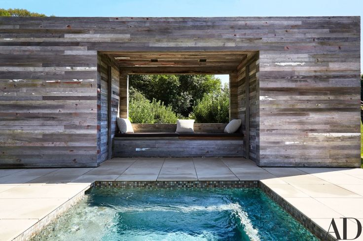 At the Hamptons getaway of powerhouse gallery owner Dominique Lévy and movie producer Dorothy Berwin, the architecture, the furniture, and even the trees are all part of the aesthetic vision. The poolhouse is wrapped entirely in reclaimed barnwood | archdigest.com