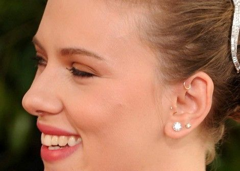 Scarlett Johansson - love how pretty and delicate her antihelix piercing is.. Next piercing maybe?