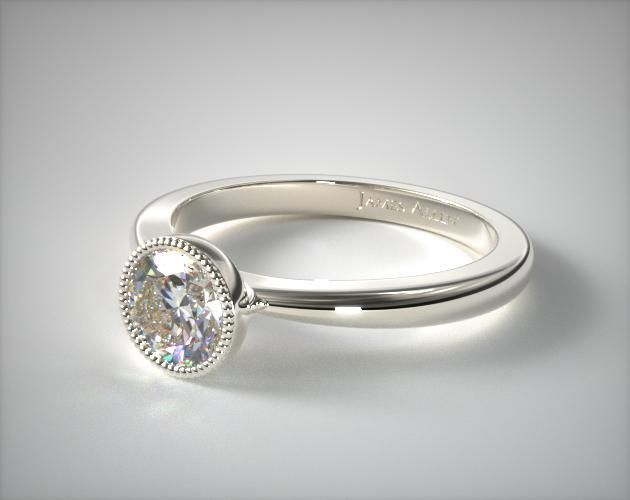 14K White Gold Milgrain Bezel Solitaire Engagement Ring | A tapered Bombay shank coupled with a delicate milgrain bezel, truly captures the heart of the modern and vintage movement. Exquisite craftsmanship and attention to detail make this simple ring a captivating showpiece. | Ring Style: 17567W14 on JamesAllen.com. Click to view this ring in 360° HD.