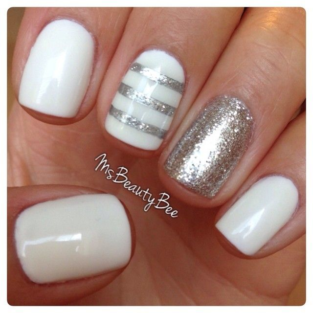 White & Silver Striped Nails.  Gelish - Arctic Freeze (White). For the stripes I used Vinyl Tape & Sally Hansen Insta-Dri - Silver Sweep & a little bit of glitter on top.  Accent Glitter Nail - Martha Stewart Silver Glitter scrubbed in. #Manicure