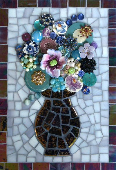 good use of broken tiles to create pattern, then use found objects to add 3D effect