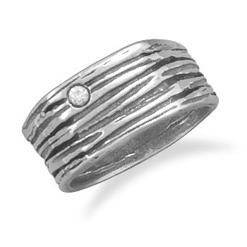 Google Image Result for http://www.twigs925sterlingsilverjewelry.com/wp-content/uploads/cache/83101-Textured-oxidized-sterling-silver-9mm-band-with-a-2.5mm-clear-CZ.-This-ring-is-available-in-whole-sizes-6-10.-.925-Sterling-Silver_355.png