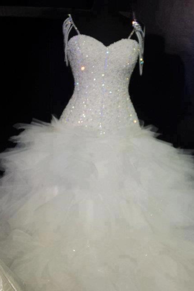 Crystal beaded feather wedding dress weddings for Wedding dress with feathers on bottom