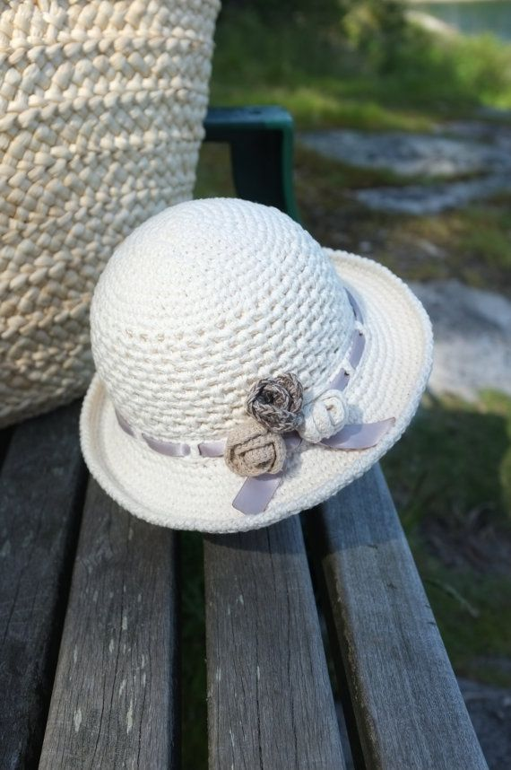 Crochet Summer Hat Baby Toddler Girls Sun Hat Cotton Infant Girls Easter Hats Floppy Hat Cream Photography Props Baby Girl Shower Gift  Little lady summer hat is hand made from 100% cotton yarn in popular off- white or beige(pic.2) colors. This hat features a simple crochet pattern with mesh panel for breathability and wide brim for suns rays protection. Three crochet roses and satin ribbon of matching color give it an elegant finishing touch. Little lady sun hat would make a great baby…