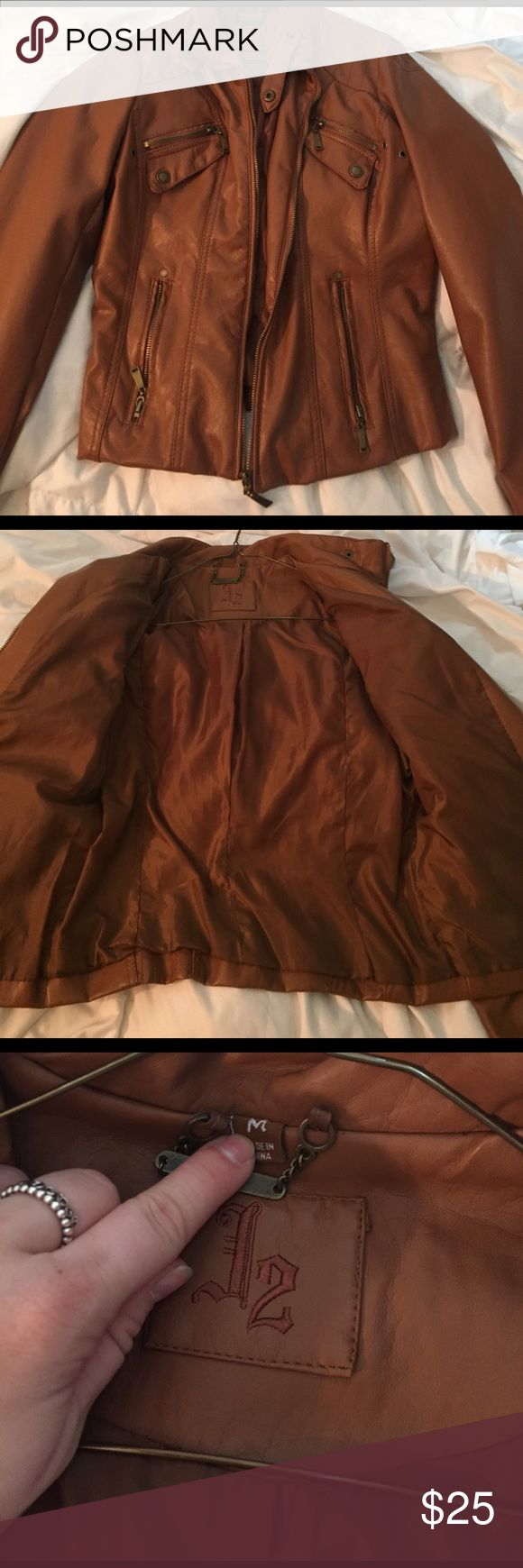 Brown leather jacket In perfect condition never worn brown leather jacket! Super cute has lots of zippers and pockets and keeps you very warm! Jackets & Coats