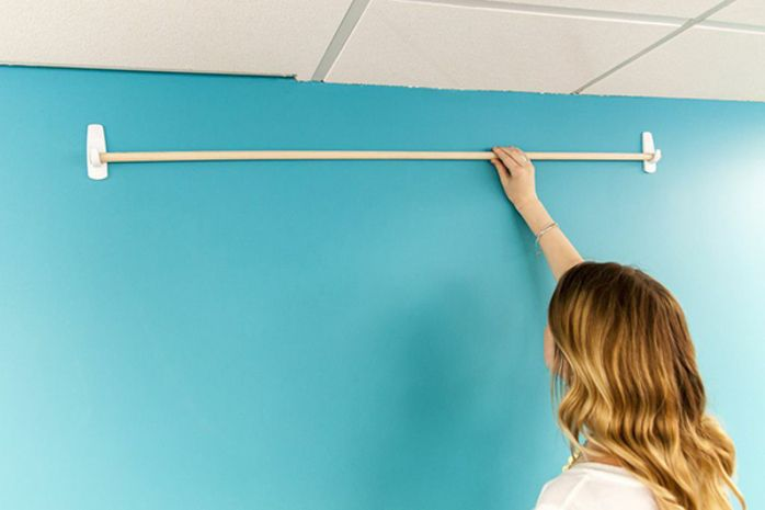 For backdrop. Use sticky hooks and a curtain rod. Then hang garland!