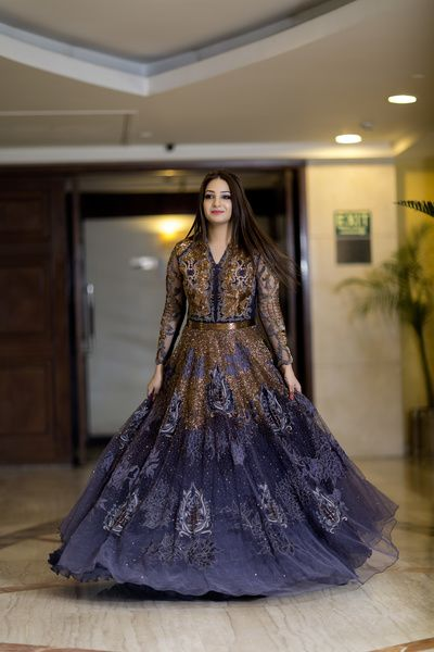 Cocktails Outifits - Bride in a Midnight Blue Cocktail GOwn with Bronze Detailing and Embroidery | WedMeGood #wedmegood #cocktailgown #midnightblue #gold #bronze #indianbride #indianwedding #bridal #gown