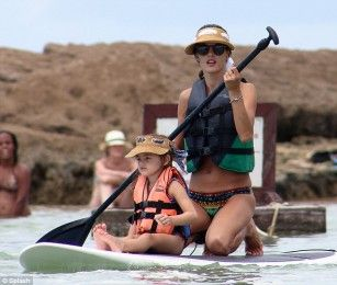 She is already the spitting image of her famous mother.  But Alessandra Ambrosio's daughter Anja couldn't have looked anymore like the supermodel as they continued to enjoy their family vacation in Porto de Galinhas, Brazil, on Thursday.