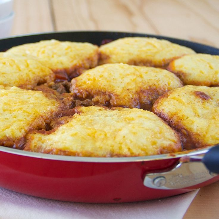 This hearty skillet features flavorful fire roasted garlic chili topped with cheesy corn bread.