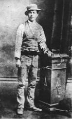 """Aaron Sherritt had grown up as a close friend of Joe Byrne. The Police actively worked to increase tensions between Sherritt and the Kelly Gang and 4 Policemen were sent to his Hut, their presence convinced the gang he was a traitor. On the 26 June 1880 Sherritt was at home with his wife, her Mother and the 4 policemen. A neighbour, who had reportedly been captured by Joe Byrne and Dan Kelly, called out """"Aaron"""". When Sherritt answered the door, Joe Byrne shot him point-blank in the chest."""
