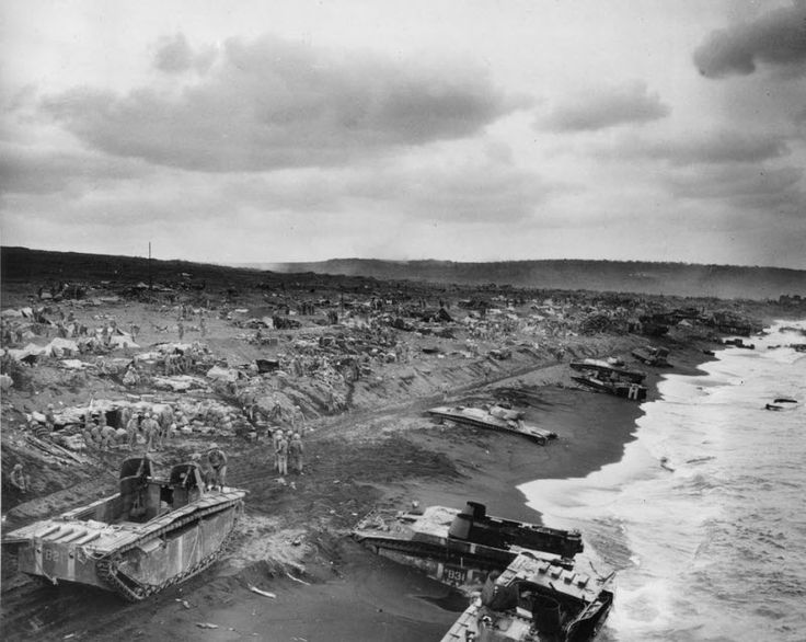 Feb. 1945: This general view shows amtracs bogged down in the sands along the beaches of Iwo Jima after the American invasion of the Japanes...