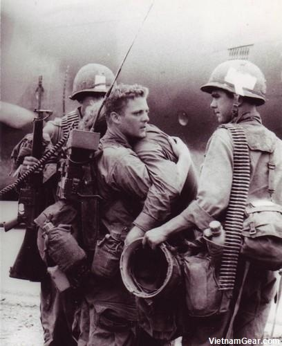 Vietnam War. A radioman comforts his friend who just survived a battle during Operation Byrd in which nearly his entire platoon was wiped out Co. A, 2/7, 1st Cav. Div. (Airmobile) 1966