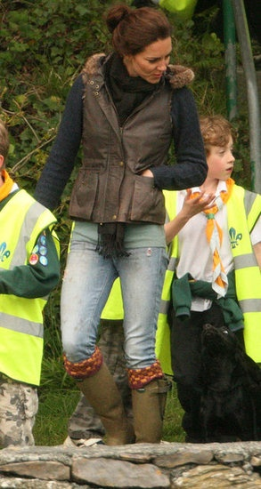 Kate Middleton Cuddles With Lupo While Camping With the Scouts: Kate Middleton got casual in Paige jeans for a camping trip near Anglesey, North Wales May 2012. The excursion was part of her volunteer work with the Scout Association, which is just one organization that she chose to support in her role as Duchess of Cambridge.