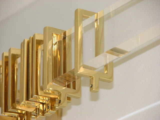 Polished brass rings on acrylic curtain rod