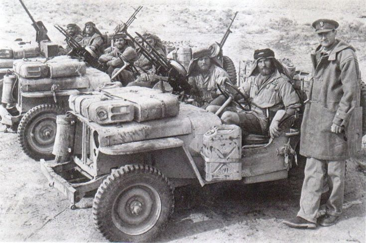 The men who did it all: A close-up of a British heavily armed patrol of L Detachment SAS in their jeeps, just back from a three month patrol, 18 Jan 1943; note twin-mounted Vickers K machine guns.