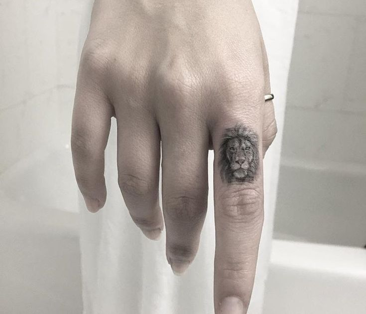 Small lion tattoo by Evan Weidner