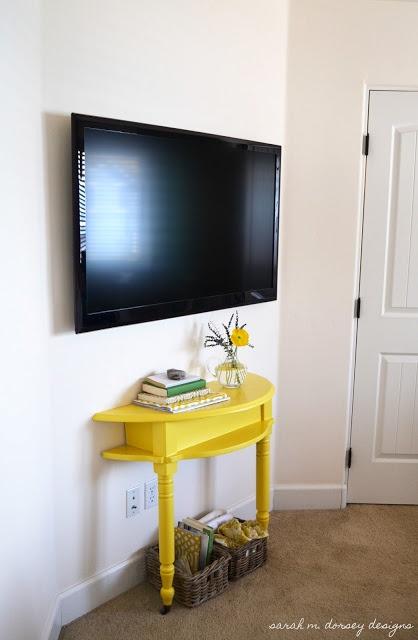 Demilune table under TV