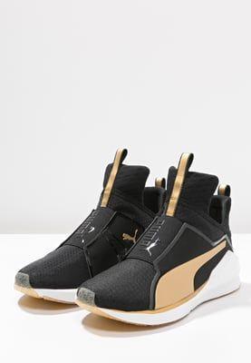 6e6ed97f15e Puma FIERCE FIF - Sports shoes - black gold - Zalando.co.uk ...