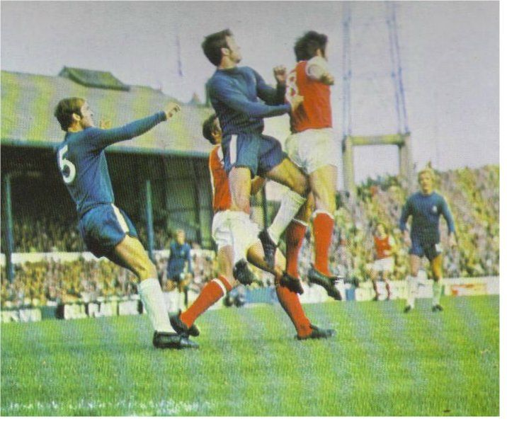 27th September 1969. Chelsea's John Hollins and Arsenal's Jon Sammels leap for the ball during this comprehensive 3-0 home win at Stamford Bridge.