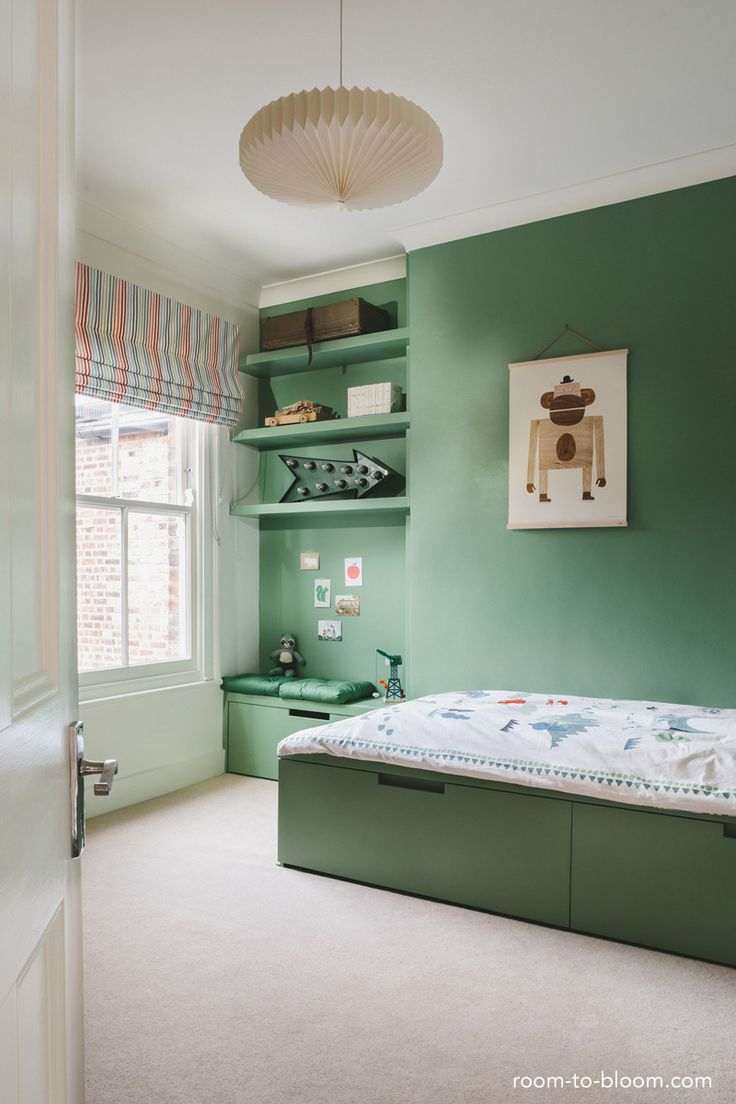 green is great for a kids bedroom with such a simple bedroom this leaves loads