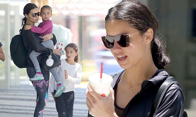 The mother-of-two looked stunning as she sipped on a smoothie and donned some dark shades to shield herself from the blazing sun.