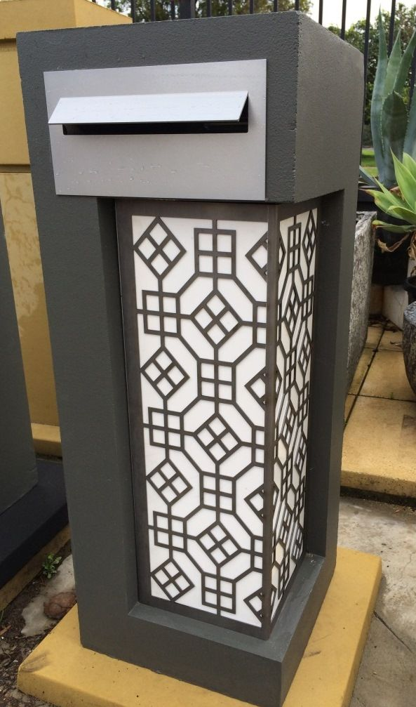 Charcoal Medusa letterbox with white perspex and laser cut screen and modern front plate