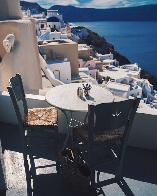 Sit at this table in Santorini...