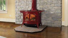The Encore from Vermont Castings, shown with optional warming shelves. This stove will keep a larger room nice and warm as it's rated at 8 kW as a wood burner or 12.3 kW as a multi-fuel stove. Available in black or a range of wonderful enamel finishes. Thermostat and top plate as standard.