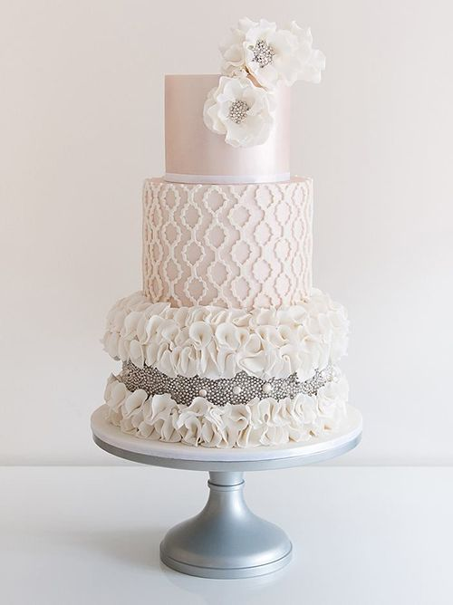 A pale pink #weddingcake with silver beading | Brides.com