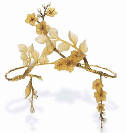 a tiara with horn leaves, apple blossoms, diamond pistels, and textured gold branches and twigs, enhanced by baroque pearl buds by Paul Leinard. c. 1905. It sold for $60,000.