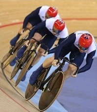 416a: This relatively neutral image depicts the British track cycling team in action. Their bent heads show their dedication and drive to win the gold.