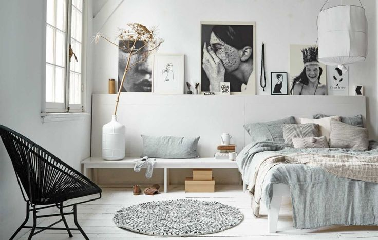 Bed against wall in 2nd bedroom, neutral grays