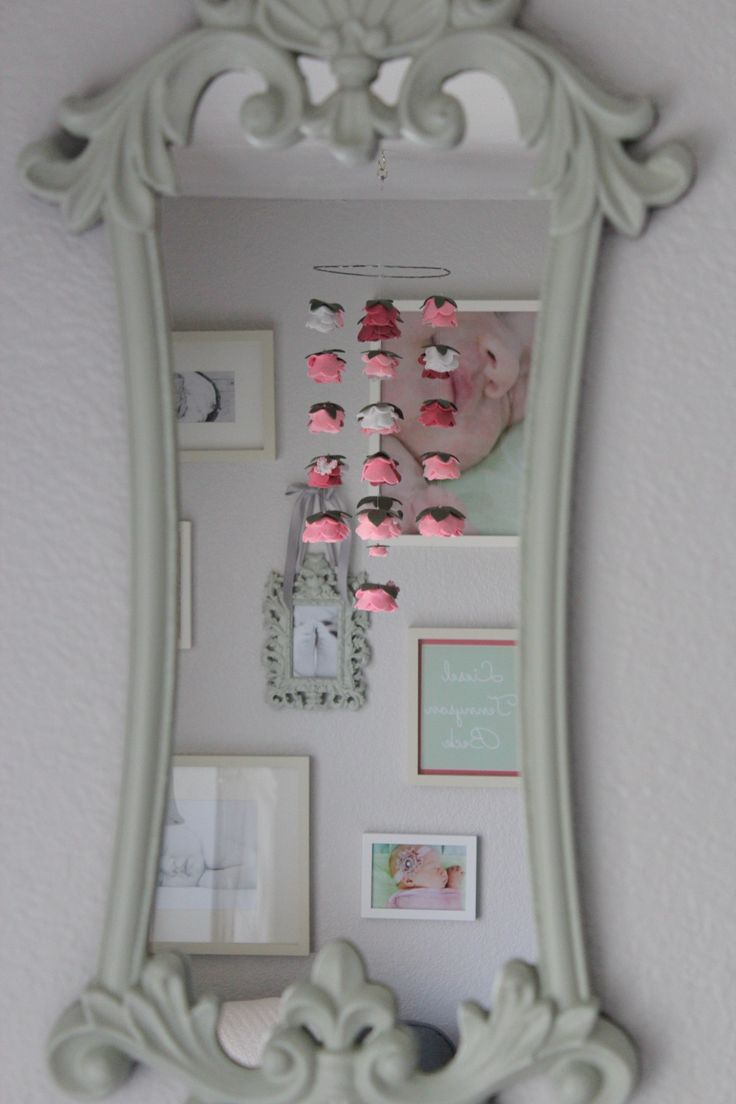 Liesel's Room: baby girl mobile for shabby chic, victorian nursery in pink, mint, creme. Mirror: $25 at Hobby Lobby, repainted. Mobile: $110 on etsy #allysen . White frames: PBK. Center frame: $5 at Ross, repainted and ribbon added. Name Litho: generated on PicMonkey, printed for $2 on Snapfish. Photography: Julie Berset Photography.