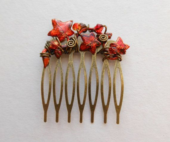 This hair comb features an ivy vine that I have colored in fiery red and orange, decorated with loops and spirals of antique brass colored enameled copper wire and sparkling Swarovski crystals in red/orange/yellow colors matching the vine. The vine is held securely to the antique brass tone comb with wires -- no adhesives used. I have created the rich colors of the leaves myself using permanent, waterproof alcohol inks, and sealed them with repeated layers of weatherproof gloss varnish…