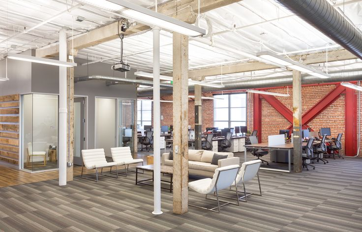 Painted White, The Open Ceiling In This Non Profit Headquarters Provides A  Light, Airy Feel. A Soffit Enclosure Was Conceived To Reduce Noise And Iu2026